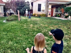 Kids digging our neighbor's Halloween decorations.