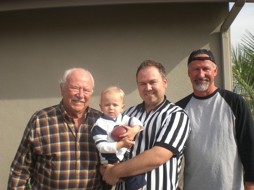 For his second birthday, we themed it Jax Bowl. That's why I'm wearing the referee shirt. My dad and my grandpa. Four generations.